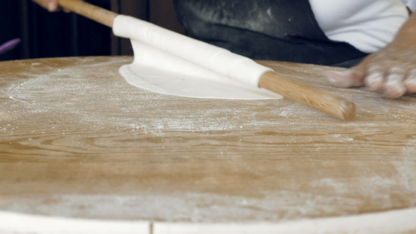 Download Rolling The Pastry Dough On a Flat Wooden Surface nulled download