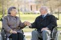 elderly couple on their wheelchair