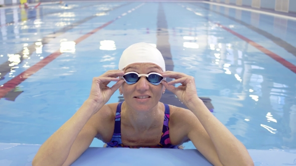 Download Female Swimmer Training In Swimming Pool nulled download