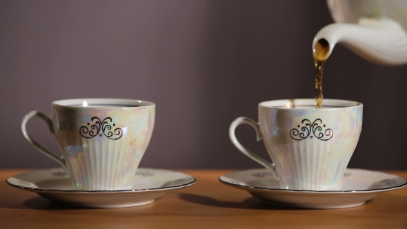 Download Tea Being Poured Into Cup nulled download