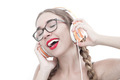 Woman with headphones listening music . Music teenager girl danc