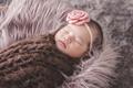 little baby girl sleeping comfy on fur blanket