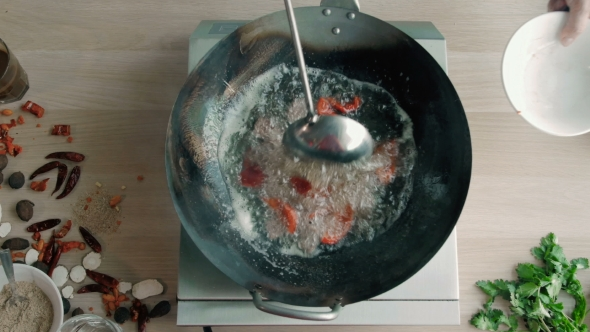 Download Chef Is Stirring Vegetables With Meat In Wok At Commercial Kitchen nulled download