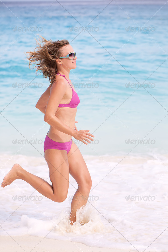 Young Woman Jogging - Stock Photo - Images