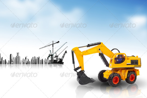 excavator against a cityscape  - Stock Photo - Images