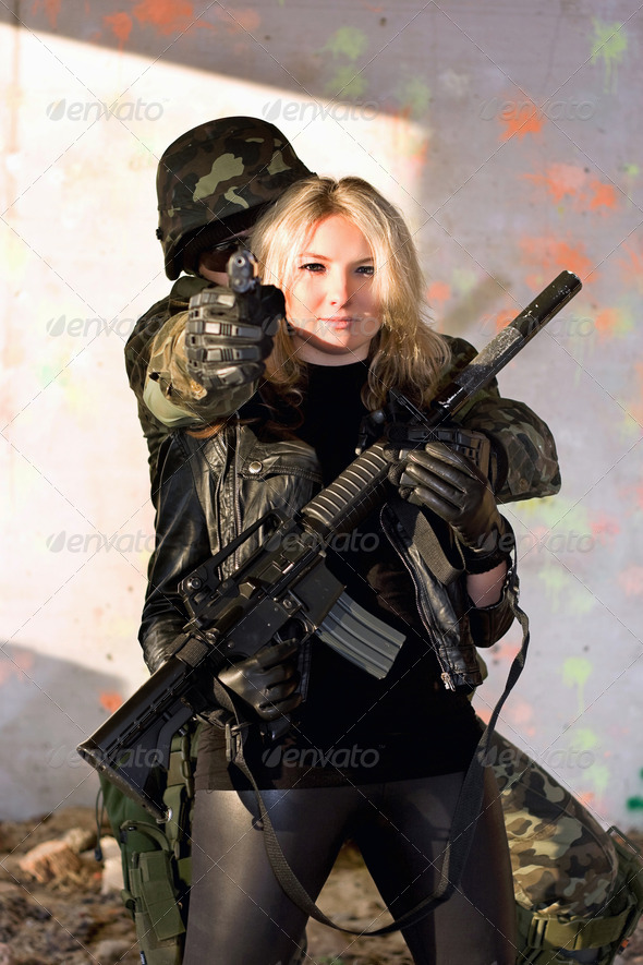 Soldier and girl with a weapon - Stock Photo - Images