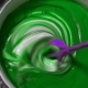 The Process Of Mixing White Paint With a Color Tinge In The Bucket Drill With a Special Nozzle
