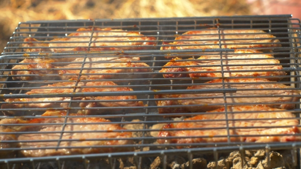Download Grilled Pork Steaks Over Flames And Coals, On The Brazier nulled download