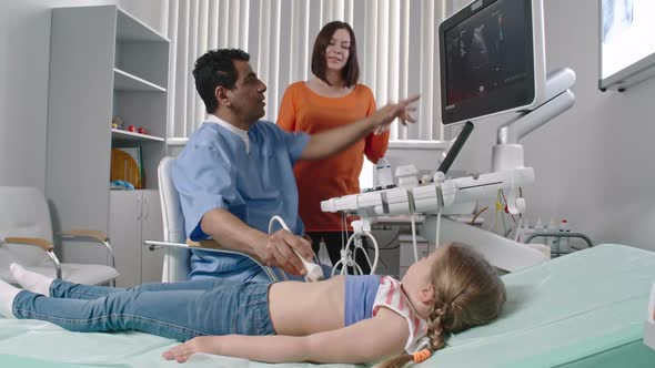 Download Doctor Doing Ultrasound on Little Girl nulled download