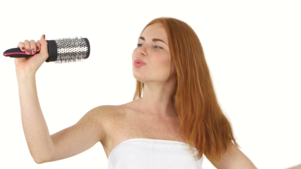 Download Young Girl Singing Using a Brush As a Microphone, Bathroom nulled download