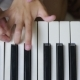 Woman Teaching Little Girl To Play The Piano. Musical Instruments