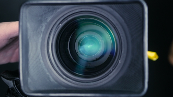 Download Studio Camera. Cameraman Changing Camera Settings Focal Length, Aperture And Zoom Preparing For nulled download