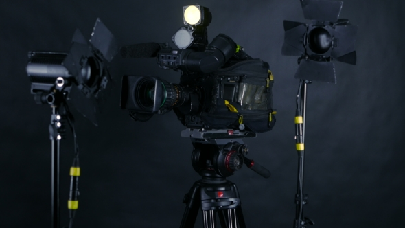 Download Camcorder, Video Camera And Professional Studio Lights In a Broadcasting Studio. nulled download