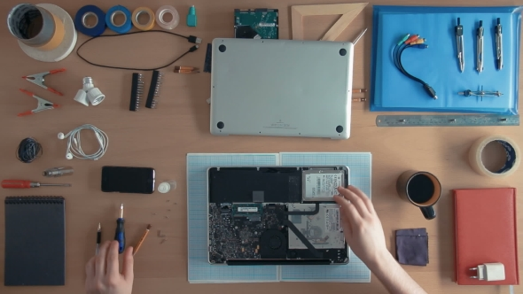 Download Top View Technician Engineer Is Repairing Laptop Computer On His Desk Surrounded By Supplies And nulled download