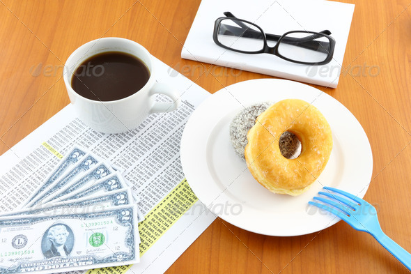 Sugar and chocolate donut on working table. - Stock Photo - Images