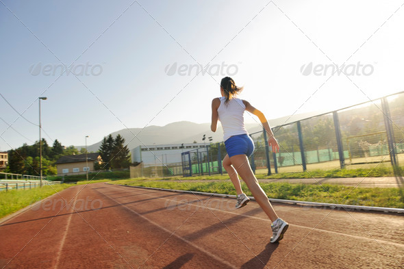 woman jogging at early morning - Stock Photo - Images