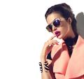 Beauty fashion model girl with brown hair wearing stylish sungla