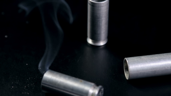 Download Weapons Shells Falling On The Table With The Smoke nulled download