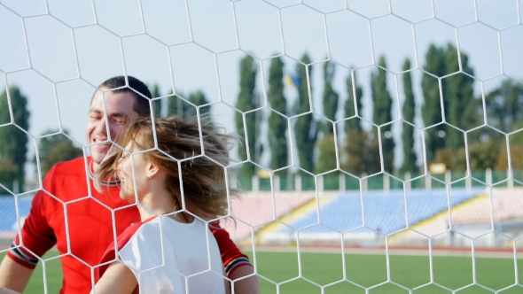 Download a Young Man And a Beautiful Girl Dancing On The Football Field nulled download