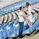 Lovers Kiss In a Football Stadium