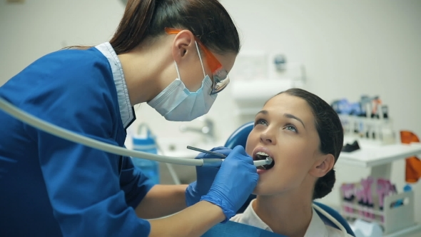 Download Woman Treats Teeth At The Dentist nulled download