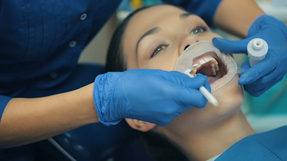 Download Woman With Rubber Dam In a Mouth At a Dentist nulled download