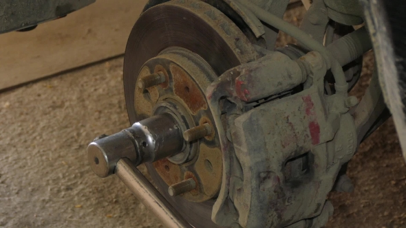 VideoHive Mechanic Dismantling Brake Disk Of Car 17867133