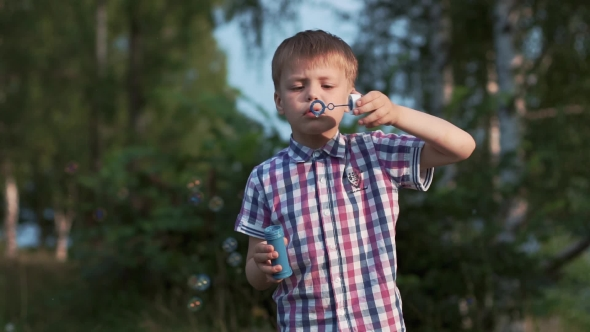 Download Cute Boy Outdoor Playing With Soap Bubbles nulled download