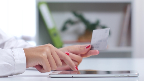 Download Woman Buying Online With a Silver Credit Card And Tablet.  nulled download