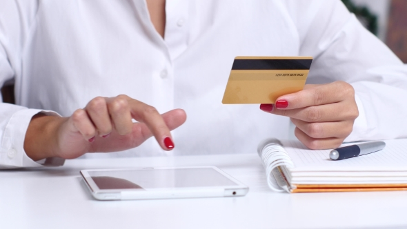 Download Girl Completes An Online Purchase And Enters The Data On The Card.  nulled download