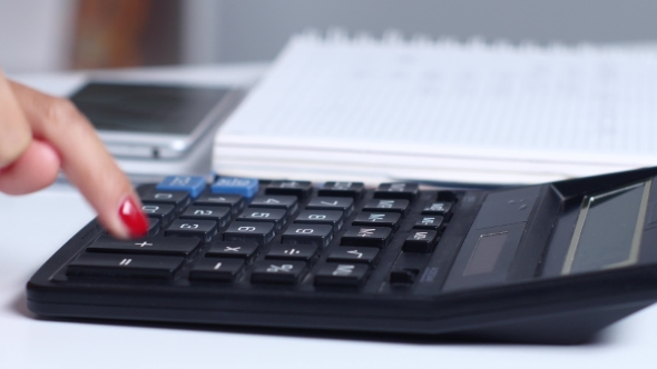 Download Office Worker Doing The Math On a Calculator.  nulled download