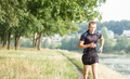 Young athletic man jogging in morning park