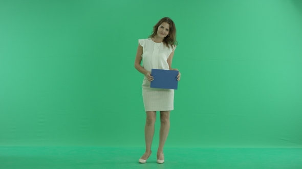 Download Girl Showing a Blue Screen On a Green Background nulled download