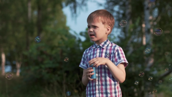 Download Boy Outdoor Playing With Soap Bubbles nulled download