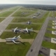 Aerial view of small airport with planes in the forest