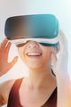 Smiling woman using the virtual reality headset