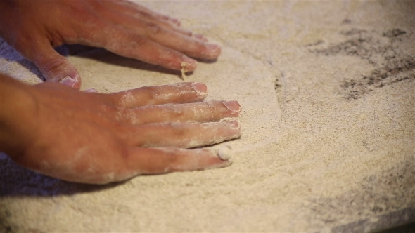 Download Baker Hands Kneading Dough In Flour On Table nulled download