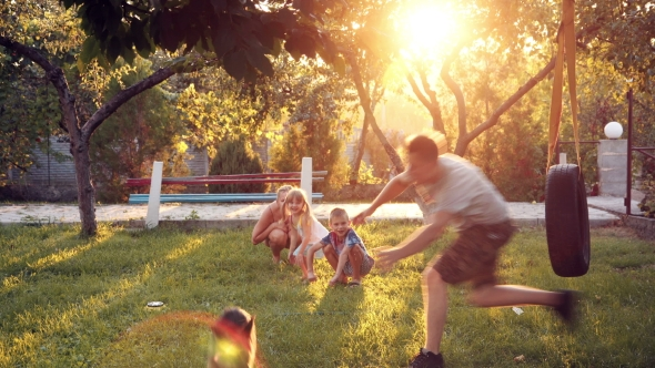 Download Parents Playing With Dog And Children At Home On Backyard nulled download