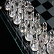 Clear Glass Chess Pieces In Starting Position On Board