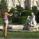 Woman Photographs a Statue on a Mobile Phone