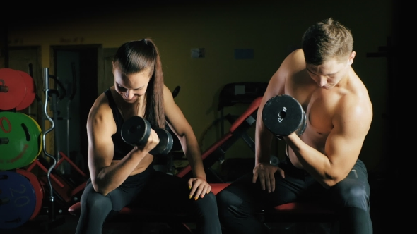 Download Man and Woman Working His Arms at the Gym. nulled download