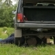 Country Man Lying Under His Car And Repairs