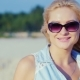 Sexy Blonde Woman In Sunglasses, Posing For The Camera At The Beach