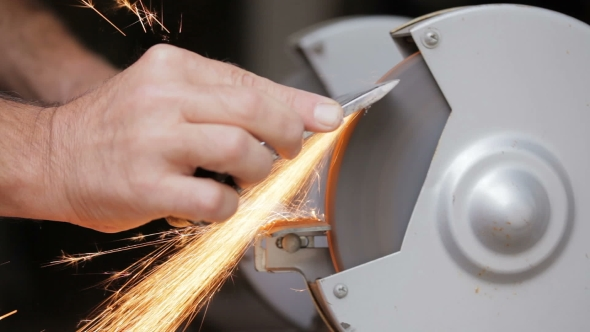 Download A Man Sharpens a Metal Part Of The Machine nulled download
