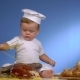 Baby Baker Playing With Bread In Cook Hat