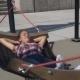 Woman Swinging In Hammock In Modern Park