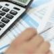 Businessman Analyzes Financial Data Calculator
