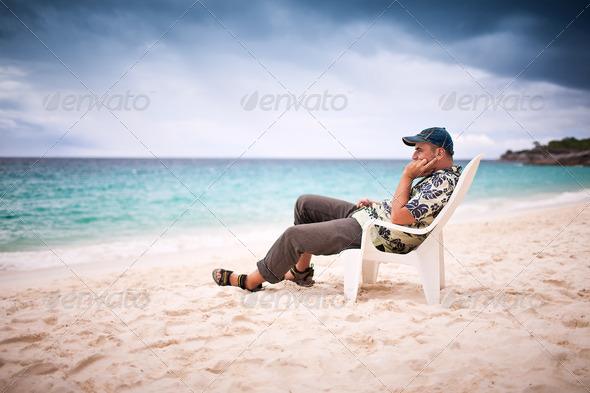 Pensive man near the beachfront - Stock Photo - Images