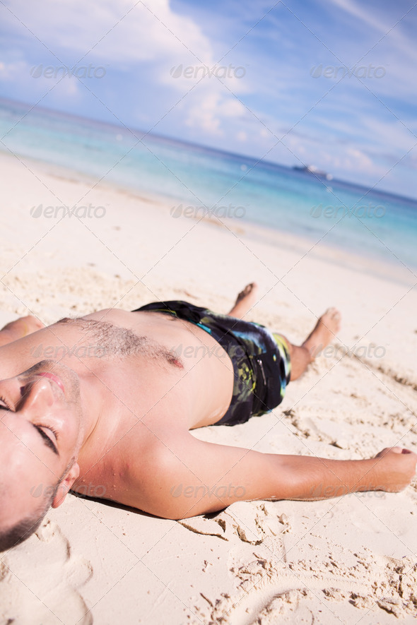 Man Sunbathing - Stock Photo - Images