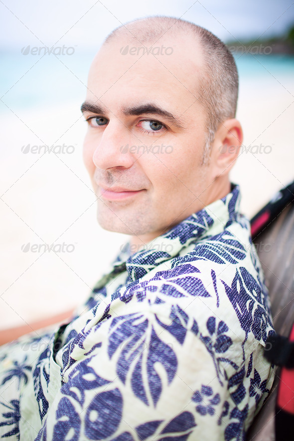 Young man on the beach - Stock Photo - Images